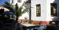 Make cheap reservations at a hotel like El Azul Guesthouse